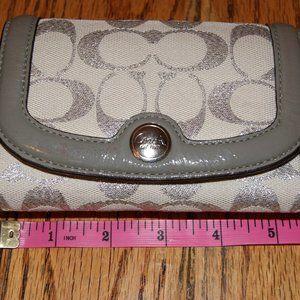 White, silver, & grey Coach wallet
